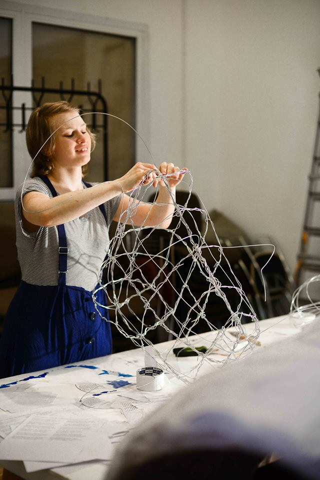 Fox Larsson working on wire sculpture