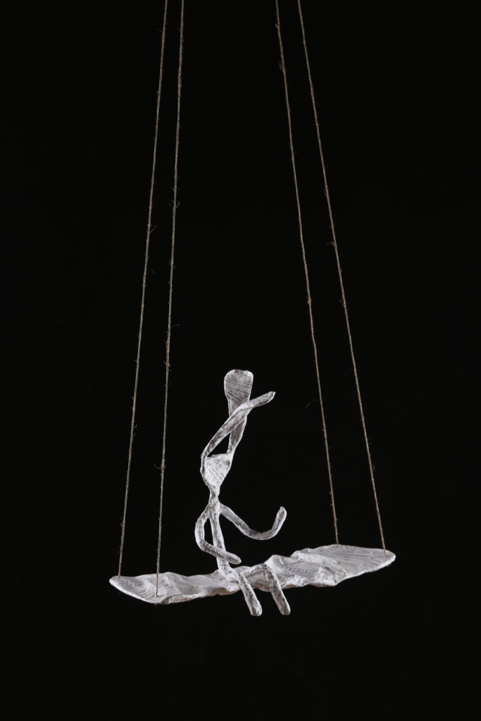 Rabbit on Swing Sculpture in wire and paper mache by Fox Larsson